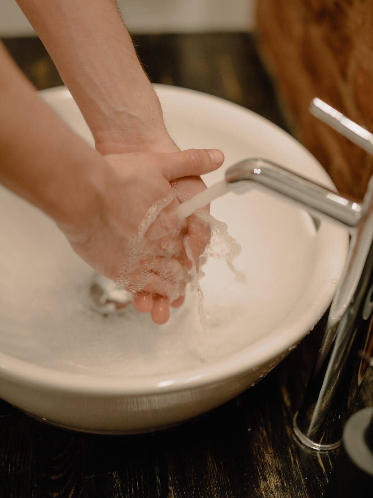 Canva-Person-Washing-Hands-1200x1600.jpg